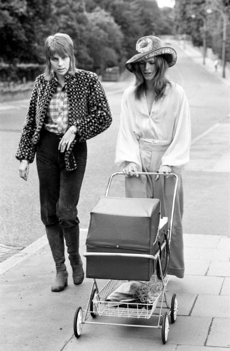 "Here's David and Angie Bowie taking their then 3-week-old baby Zowie out for a walk in June of 1971. Their son's birth (and a Neil Young album) inspired the song ""Kooks"" on Hunky Dory."