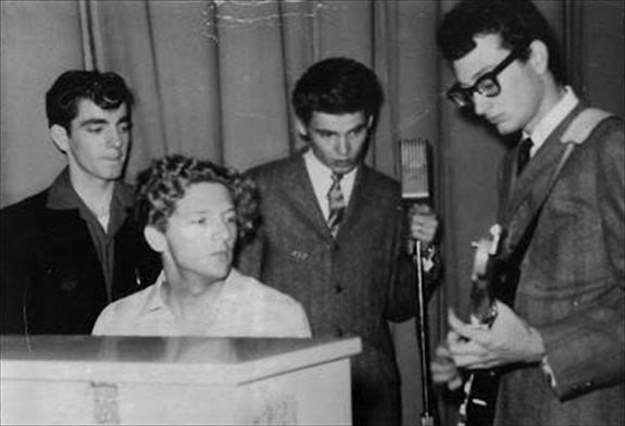 Buddy Holly shows Jerry Lee Lewis, Don Everly, and Jimmy Velvet how it's done