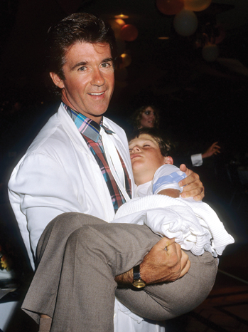 LOS ANGELES - JUNE 1986:  Actor Alan Thicke and son Robin Thicke attend the opening of singer Olivia Newton-John's new boutique Koala Blue in the Westside Pavilion Mall in June 1986 in Los Angeles, California. (Photo by Donaldson Collection/Michael Ochs Archives/Getty Images)