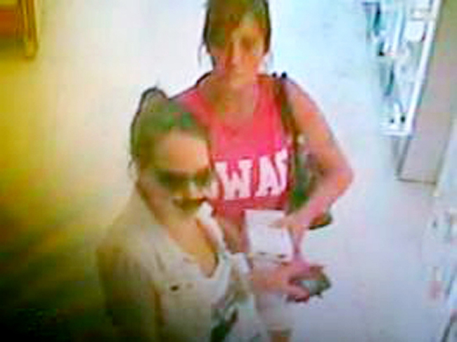 Unusual disguise: The woman wearing a fake moustache and nose was spotted in Boots with a friend (Picture: Wiltshire Police/PA)