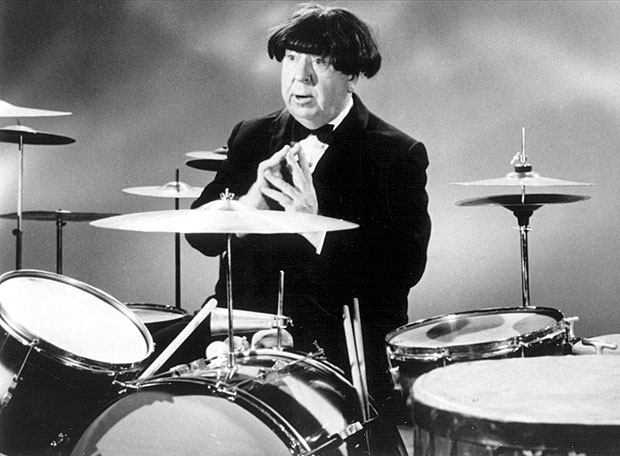 Alfred Hitchcock wearing a Beatle wig, 1964
