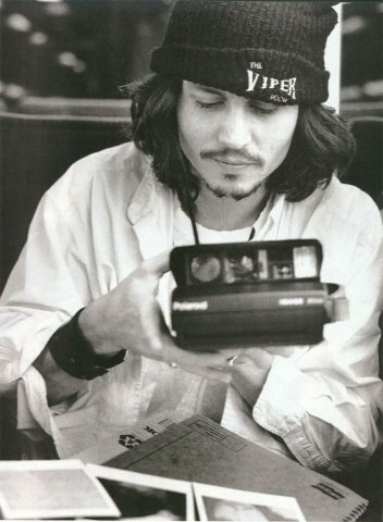 Johnny Depp with a Polaroid