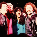 Donna Summer performs onstage with the vocal group Brooklyn Dreams which consisted of Joe Esposito, Eddie Hokenson and Bruce Sudano, on February 20, 1979 in Los Angeles, California.