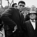 Muhammad Ali being scared by a bee while visiting a movie set in London, 1966.