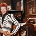 David Bowie poses beside his Rolls Royce, ca. 1973.