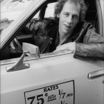 Dire Straits lead guitar Mark Knopfler drives a New York City taxi, 1979